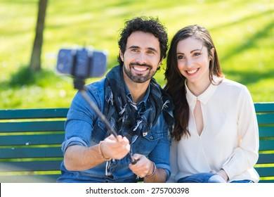 Couple using a selfie stick