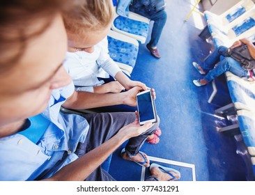 couple using smart phone in a bus. Template for an app design