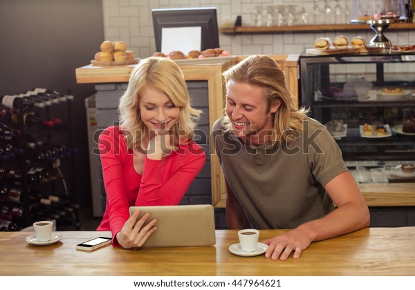 Couple using a tablet in the cafe
