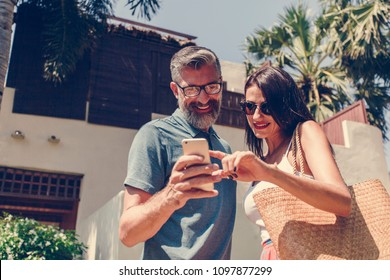 Couple using their phone while on vacation
