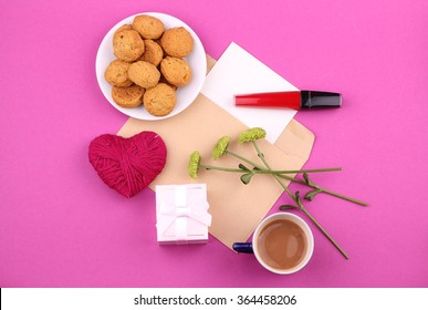 Couple Valentine - cookies with a cup of coffee, flowers with gift box and handmade heart. Red Lipstick.
