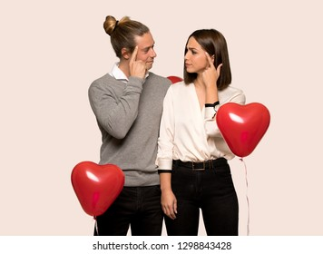 Couple in valentine day having doubts and thinking over isolated background