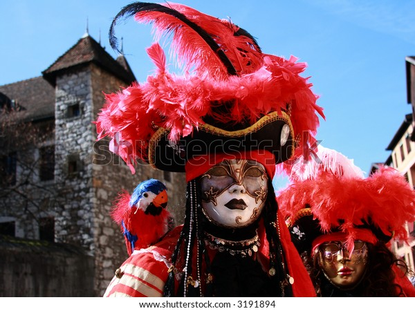 Couple with Venetian Masks and Medieval background.