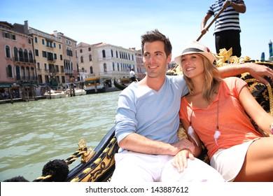 Couple in Venice having a Gondola ride on canal grande