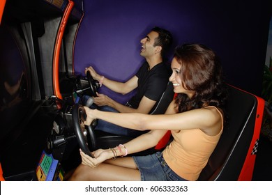 Couple in a video game arcade, playing games