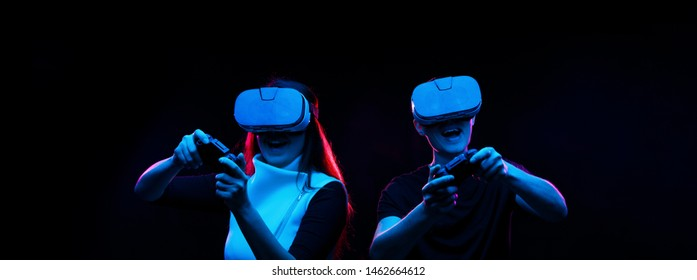 Couple with virtual reality headset are playing game.