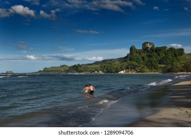 Couple wading in the ocean at Maimon Bay Riu Resorts Puerto Plata, Dominican Republic - November 10, 2014