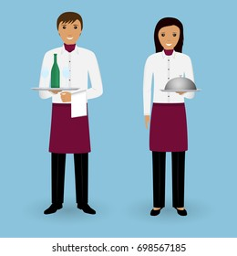 Couple of waiter and waitress with dishes and in uniform stand together. Restaurant team concept. Food service occupation staff.