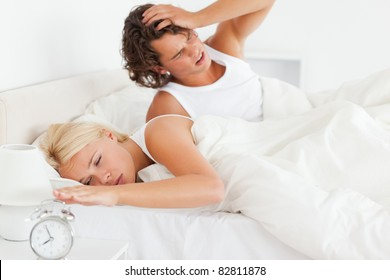 Couple waking up in their bedroom