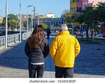 Couple waling in Caminito, La Boca, Buenos Aires