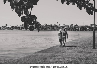 Couple walking by the water