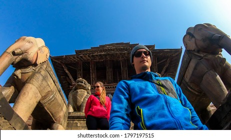 Couple walking down the stars of Nyatapola Temple in Bhaktapur Nepal. The Hindu temple has five stories. Discovering new cultures. A place of religious and historical worship. Lots of ornated statutes