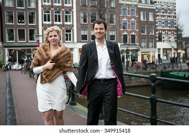 couple walking down the street in Amsterdam