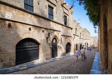 Couple walking down the street of knights (Ippoton) in City of Rhodes (Rhodes, Greece)