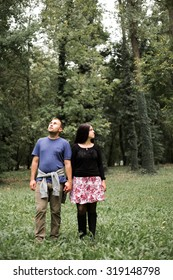 Couple walking hand in hand in autumn park