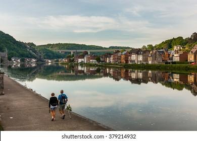 Couple walking at Meuse river near Dinant, Belgium