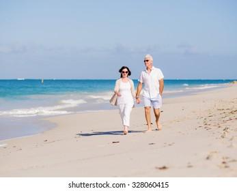 Couple walking on the beach
