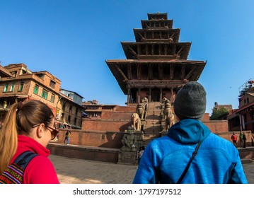 A couple walking on Taumadhi square towards Nyatapola Temple in Bhaktapur, Nepal. The Hindu temple has five stories. Discovering new cultures. A place of religious and historical worship. Spirituality