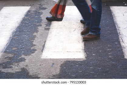 Couple walking on a zebra crossing