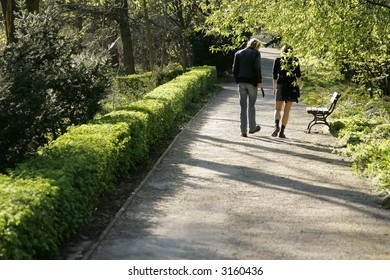 Couple walking in a Park. Man and Woman.