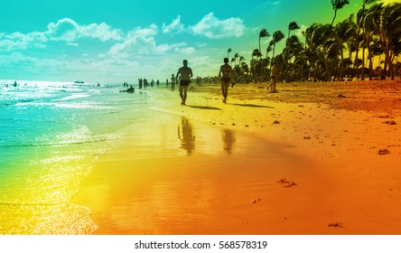 A Couple Walking at the Resort Tropical Beach in Punta Cana, Dominican Republic