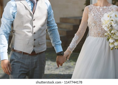 couple walking in street and holding hands