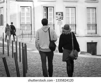 Couple walking in a street of Lisbon in Portugal