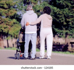 Couple walking with stroller
