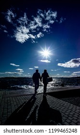 Couple walking at a Waterfront
