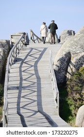 Couple walking in a wooden path way. Healthy lifestyle