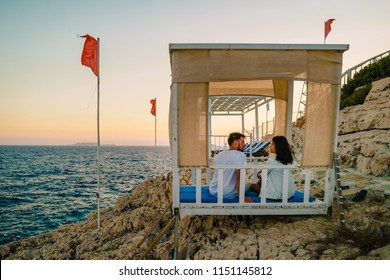 couple watch sunset by the ocean of Kas turkey