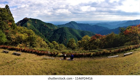 Couple watches autumn leaves at Mitake Mountain, Japan