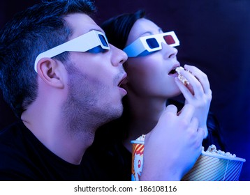 couple watching action movie in cinema