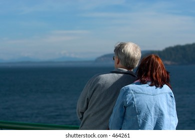 A couple watching from cruise ship