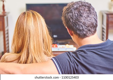 Couple watching having a movie night at home