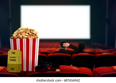 Couple watching movie with focus on popcorn and 3d glasses