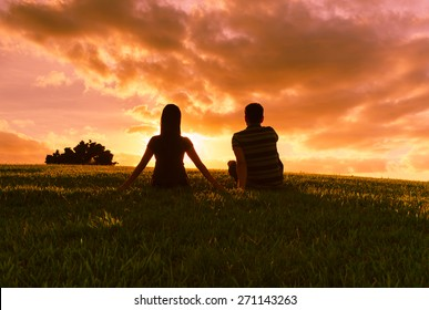 Couple watching the sunset.