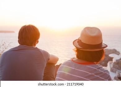 A couple watching a sunset (Oia, Santorini, Greece)