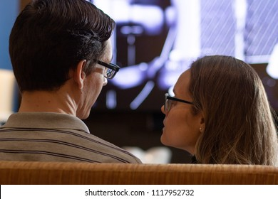 A couple watching tv/movie