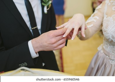 the couple wear rings