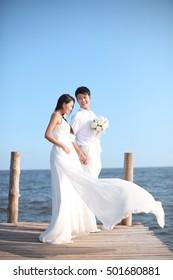 Couple in Wedding Dress on beach