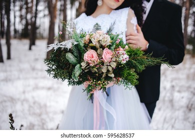 Couple with wedding flowers