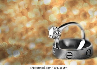 Couple wedding rings with golden Bokeh Lighting and copy space