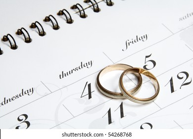 Couple of Wedding Rings on Calender symbolizing wedding date or anniversary