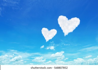it is couple white heart shaped clouds on blue sky.