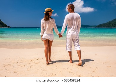 Couple in white on a tropical beach