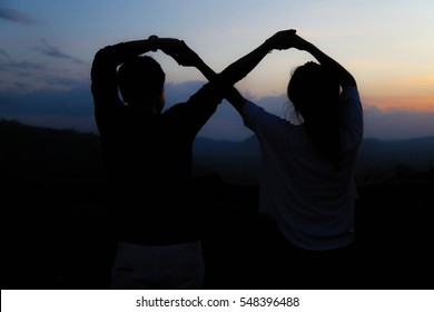 Couple will hand the symbol infinity