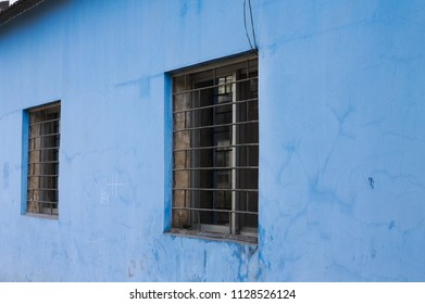 A couple of windows and a light blue wall (Kunming, Yunnan, China)