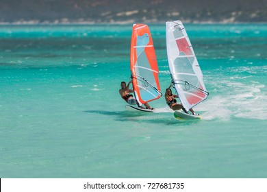 Couple windsurfers in the lagoon of Emerald Sea, Antsiranana bay (Diego Suarez), Madagascar.