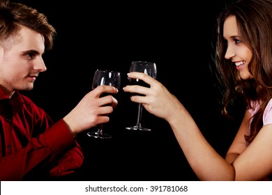 Couple with wine by a table.